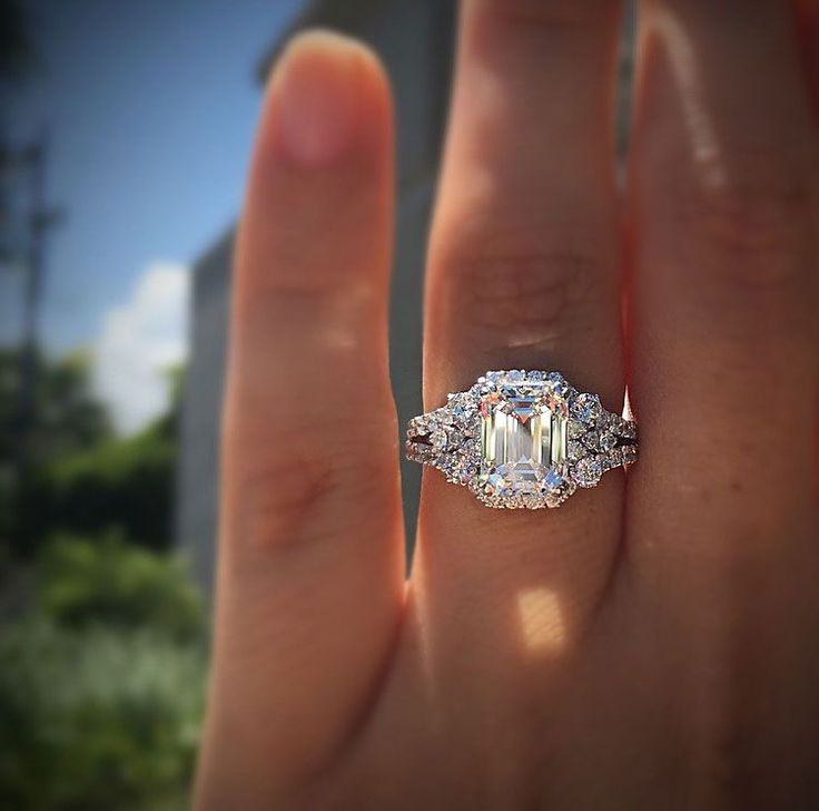 A 3ct emerald cut diamond engagement ring with accent diamonds in 18k white gold.