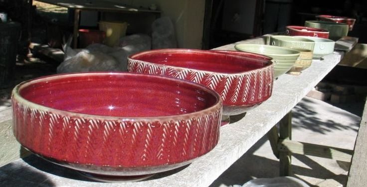 Copper red facetted bowls