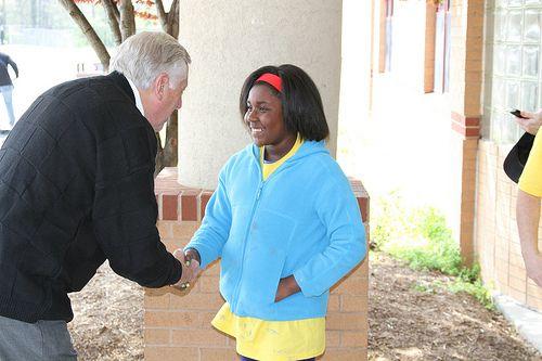 Congressman Steny Hoyer greets a young volunteer