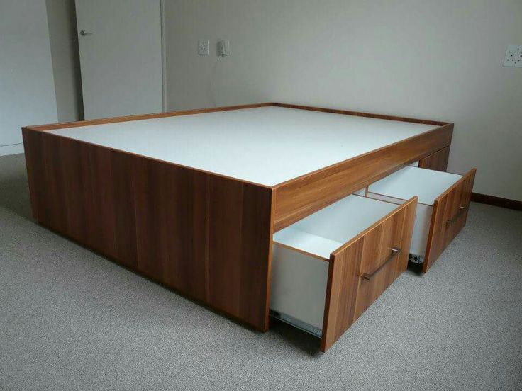 Bed base with pull-out storage on both sides.