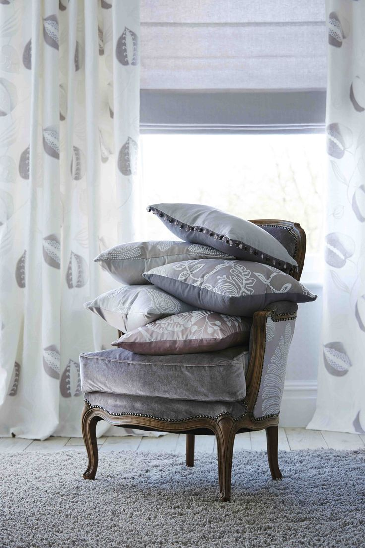 Harlequin's 'Abella' fabric from 'Purity' is a beautiful embroidered and appliquéd fabric which features a subtle seed head design. It makes the perfect curtain in a vintage, french styled bedroom.