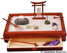 Zen garden w/ chimes, stone and candle