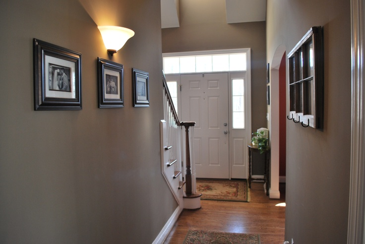 Painted the hallway bison beige and added family for Foyer paint color decorating ideas
