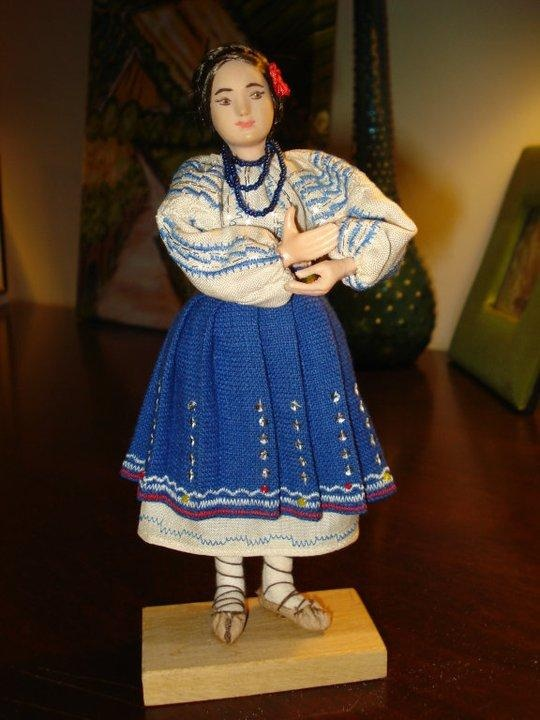 The clothing, the embroidery, the jewelry, the shoes...beautiful Romanian doll