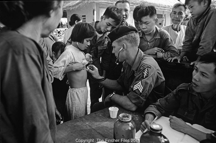 US medic of the green berets) seen helping villagers from the Montagnards tribe in the central Highlands of Vietnam in 1969. Photographed by Terry Fincher