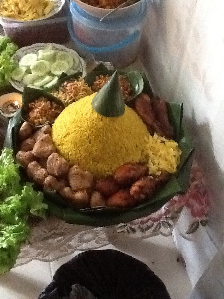 Nasi Tumpeng (Indonesian culinary for a party) this picture from my son 3rd birthday i made it!