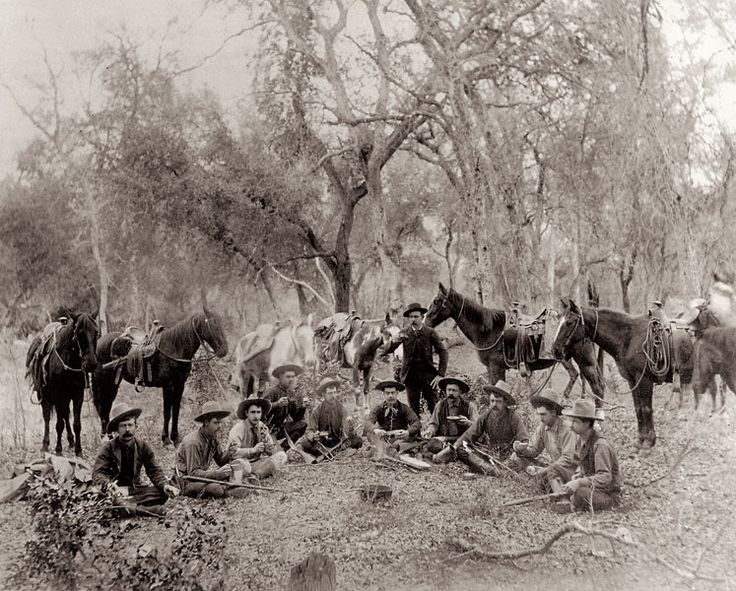 This photo of Company D Texas Rangers is one of a series of five photographs that play out a story for a photographer. The camp scene shot stands out because it has several of the most prominent Texas Rangers: Sergeant Ira Aten (standing with cup) issues the marching orders; (seated, from left) Jim King, Frank L. Schmid, Ernest Rogers, Cal Aten, Walter Jones, Charley Fusselman, J. Walter Durbin, Jim Robinson, John R. Hughes and Bass (Baz) Outlaw.  Courtesy Jeri and Gary Boyce Radder
