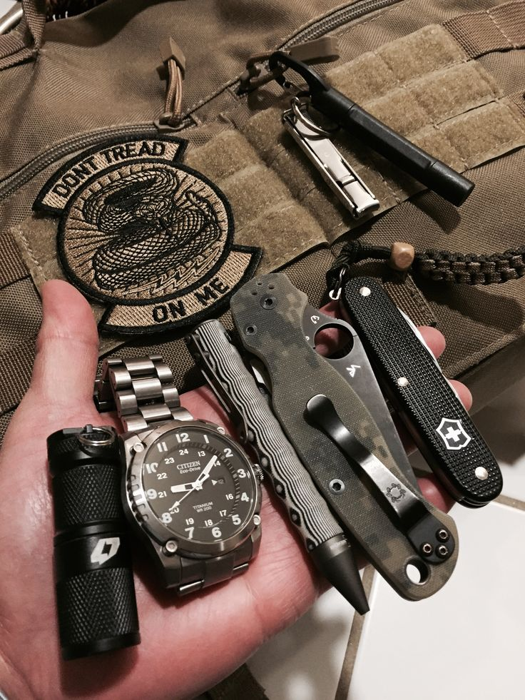 Four Seven light, Citizen solar powered watch, Boker tactical ball point pen, Spyderco Paramilitary knife, Swiss Army Cadet, 5.11 Messenger bag