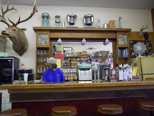 8. Chugwater  A town of roughly 200 people, Chugwater's main claim to fame is its annual chili cookoff. While the town is very small, there is a local K-12 school that serves the area. Above is a picture of a local diner, The Chugwater Soda Fountain.