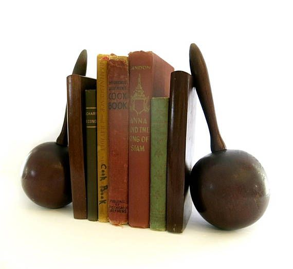Here is a pair of midcentury maracas bookends made of wood and engraved with Puerto Rico plus a tropical scene. They are a souvenir from a long ago trip. Im not sure of the wood because you cannot see the grain. Puerto Rice is abreviated with PTO Rico above the scene.  The bookends measure 8 3/4 inches tall, 5 inches deep and 3 1/2 inches wide. They are quite heavy and will be sent in a medium flat rate box. They are in very good vintage condition.