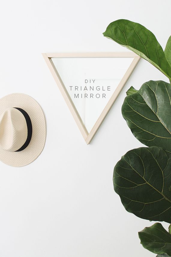 Add a unique piece to your wall decor with this DIY triangle mirror. Although simple, adding new, geometric shapes to your walls can create an eye-catching piece.