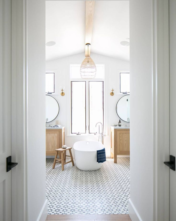 bright white bathroom with patterned floor tile