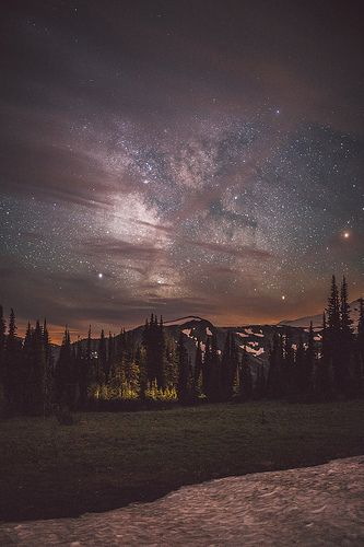 Looking at the Milky Way through the clouds in Mt Rainier National Park.  Prints available: www.redbubble.com/people/charliereynolds/works/11567430?f...