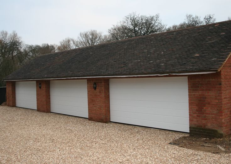 x 3 double Hormann sectional garage doors insulated and remote and fitted to one garage in Guildford UK white M ribbed sectional garage doors