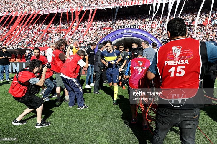Fernando Gago of Boca Juniors leads his team out ahead of the Argentine Primera Division match between River Plate and Boca Juniors at the Estadio Monumental Antonio Vespucio Liberti on December 11, 2016 in Buenos Aires, Argentina.