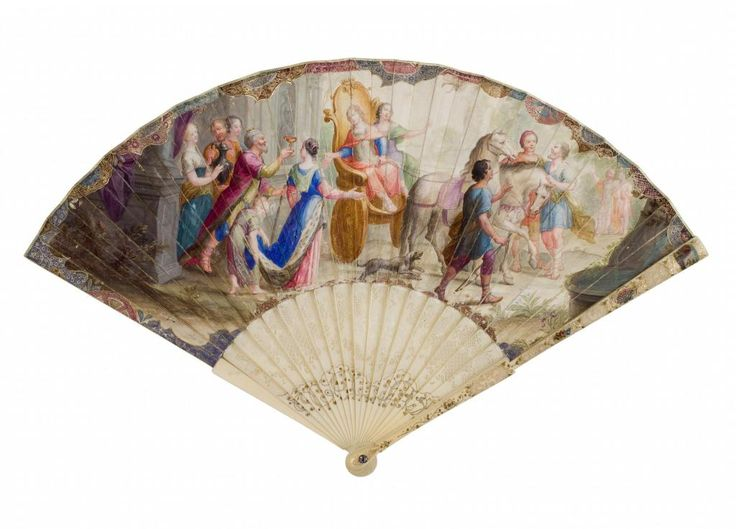 Folding fan with carved and pierced ivory sticks and guards, painted and set with gold piqué, and single fine skin leaf mounted a l'Anglaise, obverse painted in gouache with a king presenting a gold cup to a young couple in a golden chariot, reverse depicting a seated woman holding a man's portrait, part of the Richmond Inglis Cochrane Collection: probably German, c. 1730