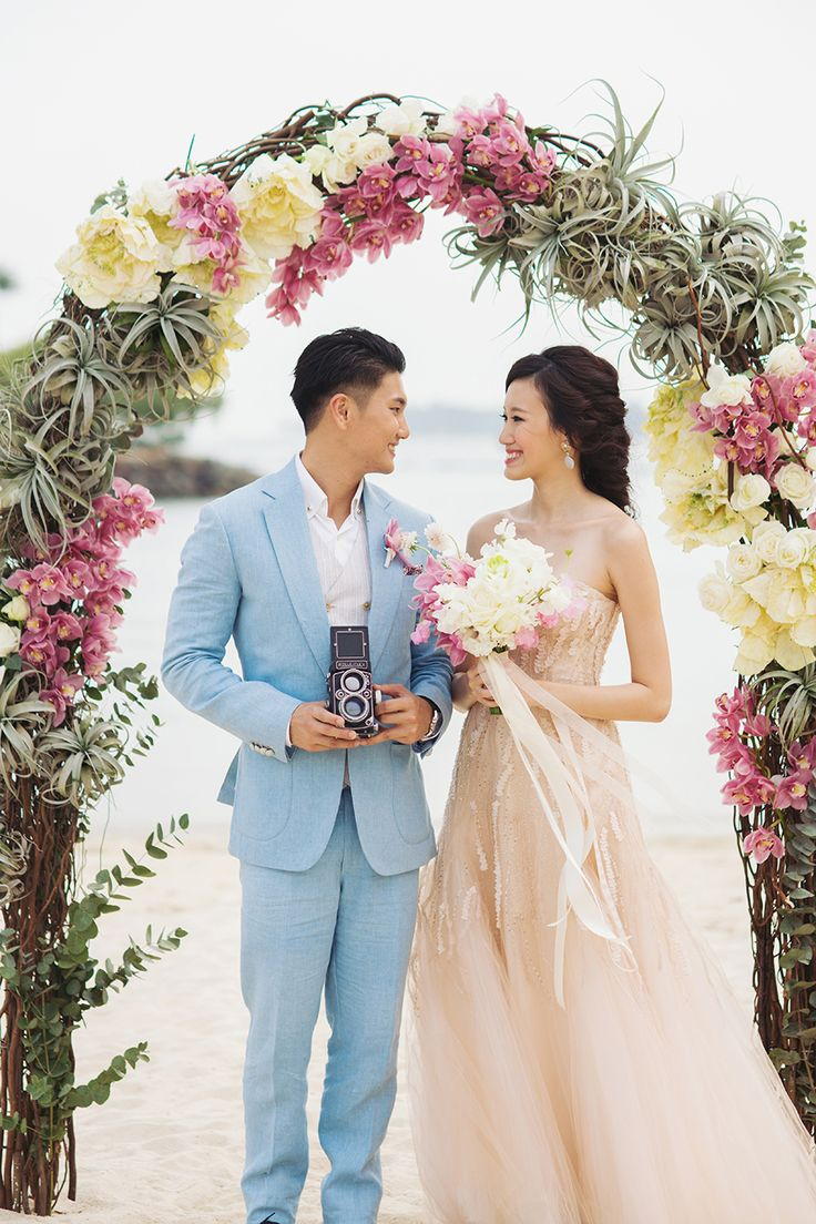 Floral arch of soft pink, dusty pink and sandy white flowers for this pastel beach wedding // Love Deeper Than the Ocean: A Styled Shoot at Tanjong Beach Club - Part 1 {Facebook and Instagram: The Wedding Scoop}