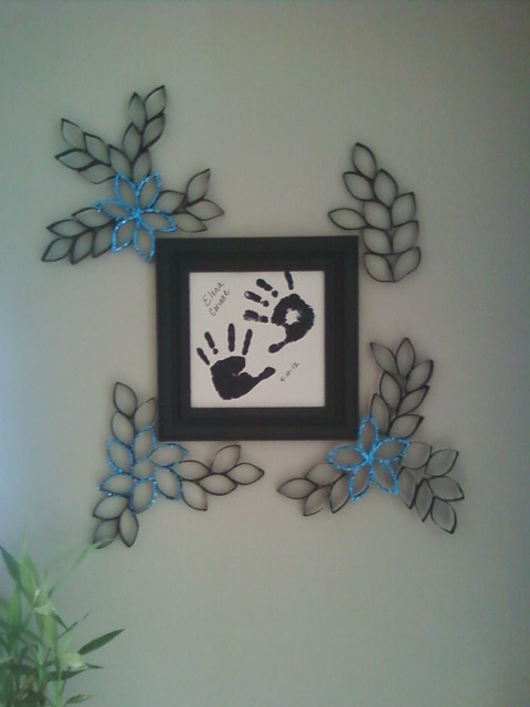 Used my paper-towel roll flowers and added them to a framed hand print memoir from my daughter.