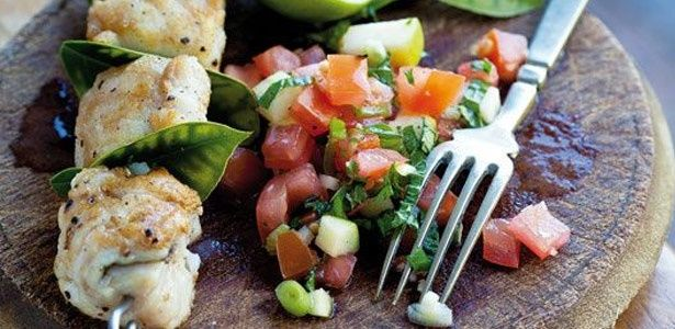 Skewered fish with chunky tomato salad