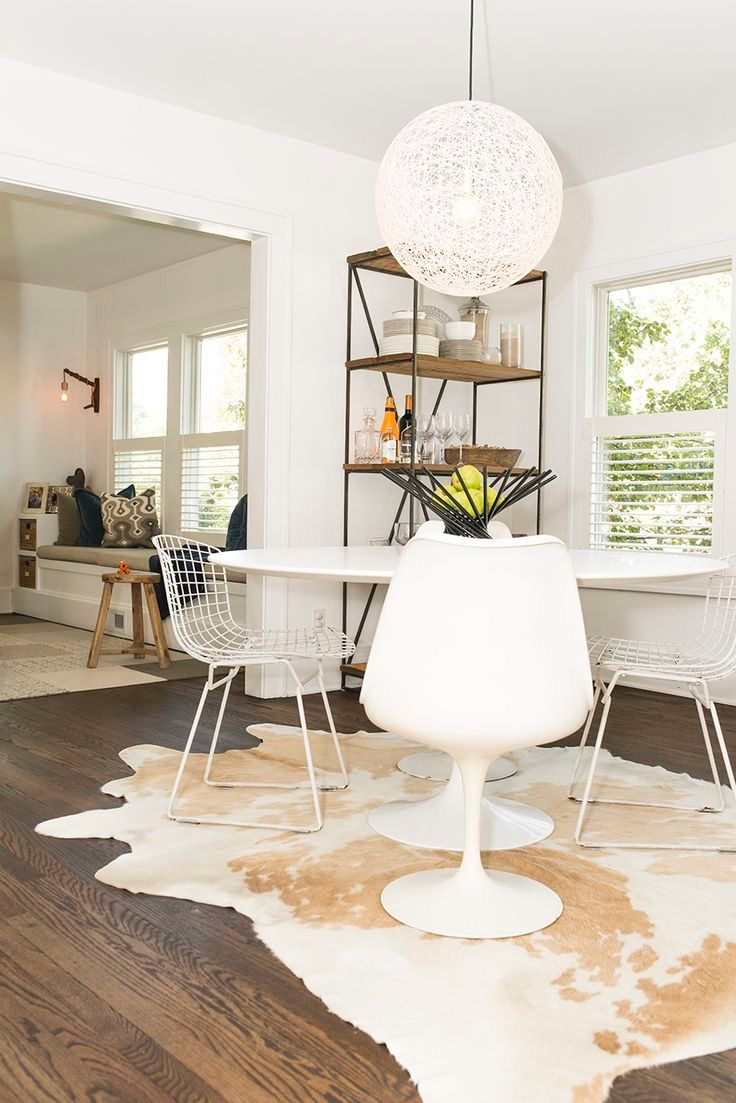 Pin By Amanda Olsson Interiors On 3775 Roberta Cowhide Rug Dining Room White Dining Table Round Dining Table Modern