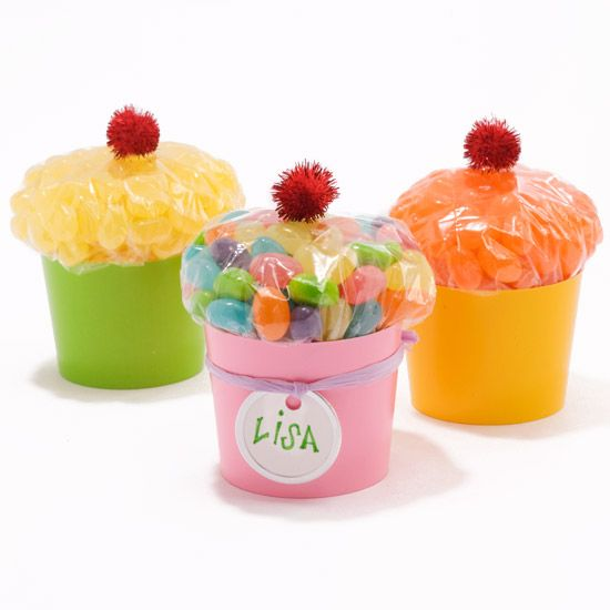 Candy Filled Cupcakes... Fill a sandwich bag with candy and close tightly. Place the bag with the closing down in a colorful plastic cup. Top with a red pom-pom cherry.