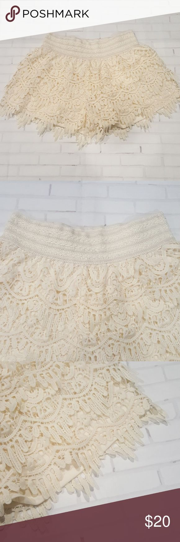 "Vanity Lace Shorts - Size Medium Ivory (cream) lace shorts by Vanity. Elastic waist and lined. Waist measures at: 13"" Inseam: 2.5"" Length from waist: 12"" *measurements are laying flat  100% Polyester  Mint condition! Vanity Shorts Bermudas"