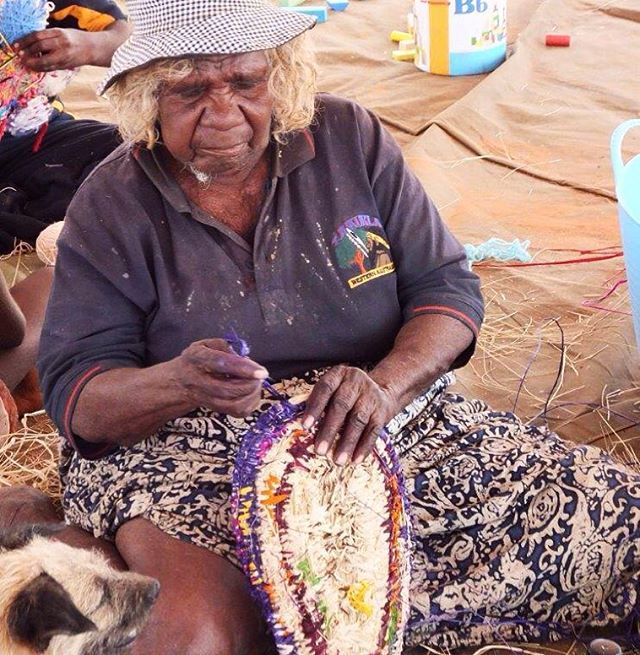 """For Yarnangu women, Tjanpi basketry was not introduced into a cultural vacuum, and there is a conscious relationship and continuity between the baskets and the traditional wooden wirra and piti.  Nyarapayi Giles: """"Both of these (baskets) remind me of mirtulpa, karnilypa, or piti - all wooden bowls. Hilarious really! They are like wooden bowls - but they are baskets! And all these others are the same. Esther's are the same. We are all reminded of the same old wooden bowls we used to use.""""…"""