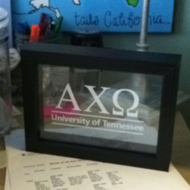 What a cute idea! Put a car decal on a clear picture frame.