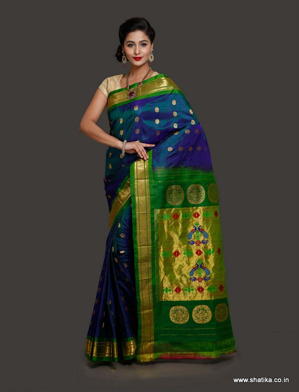 Dotted with sun-like bootis over the body and adorned with contrasting green color border and pallu is Ratnapriya Royal Blue Paithani Silk Saree. A typical choice of all Paithani lovers, this saree is elegant and graceful. Shop for this now to make a style statement.