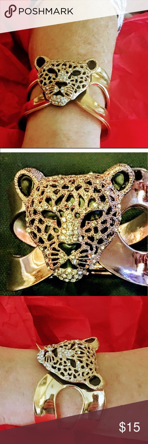 Stunning Jaguar cuff   bracelet. Last one This is a beautiful piece the head of the Jaguar white stone that dazzle the face hold metal overlay cuff  this was a big seller last one left.   Brand new never worn ticket fell off lovely  Jewelry Bracelets