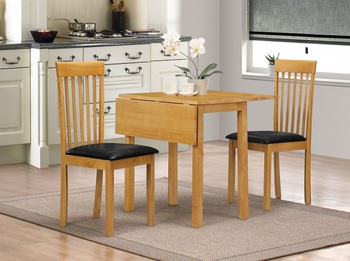 The Atlas Drop Leaf Dining Set is a 2 seater dining table with matching chairs. This set is made from solid rubberwood with a Natural Oak finish and features synthetic leather Black seat pads.  http://www.furn-on.com/atlas-drop-leaf-dining-set.html