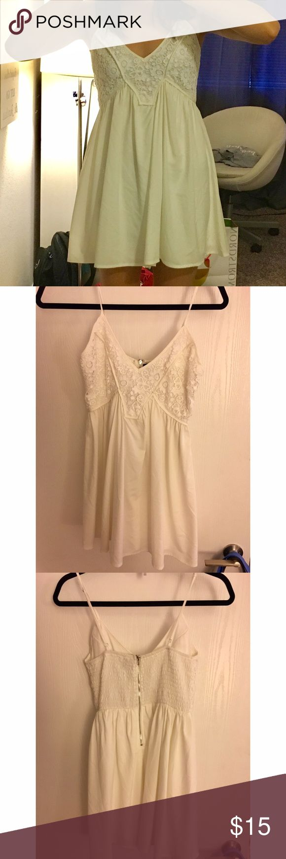 White Babydoll Australian dress One Way is an Australian brand. Dress says size 8 but this fits similar to a size 2. I usually wear dresses that are size small or 2. Material is stretchy and very comfortable. Straps are adjustable. One Way Dresses