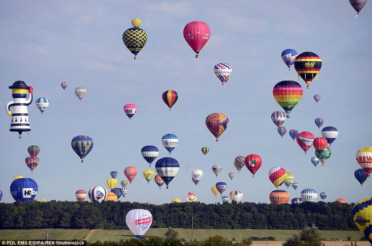 And they're off: As the balloons took off they filled the sky around Chambley-Bussieres, n...