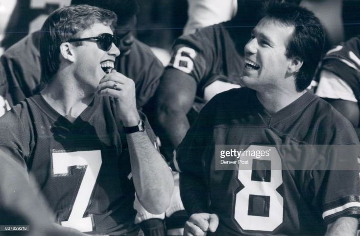 Special to the Denver post -- Denver quarterbacks John Elway and Gary Kubiak laugh it up during a team picture taken at Jack Murphy stadium this morning after interview sessions. Super Bowl Credit: The Denver Post