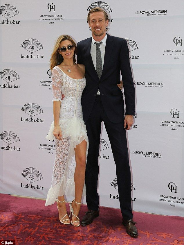 Cute couple: Abbey Clancy looked sensational as she joined husband Peter Crouch at the Grosvenor House world cup party in Dubai on Saturday