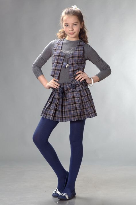 23614312a65 Young girl in dress with dark blue stockings Tween Fashion