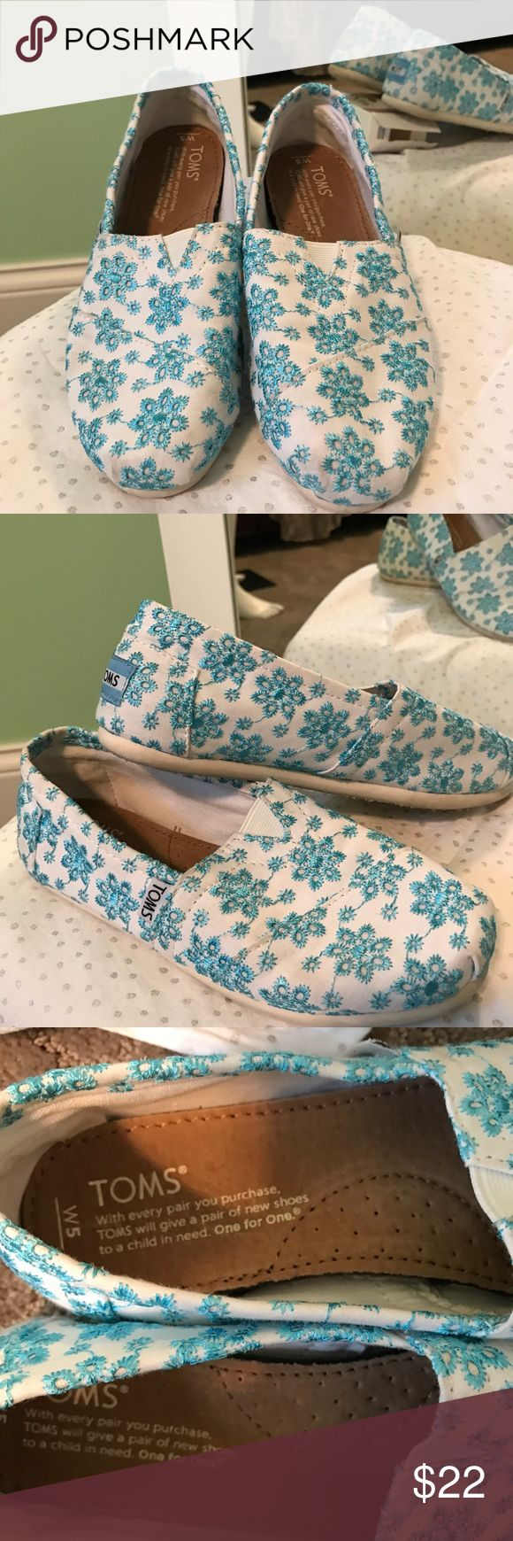Light blue floral embroidered Toms. Sweet little blue floral Toms. TOMS Shoes Flats & Loafers