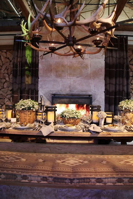 The Ralph Lauren team pulled out all the stops on their table within a cabin. Like the bench cushion, light fixture, flower baskets, the whole thing!