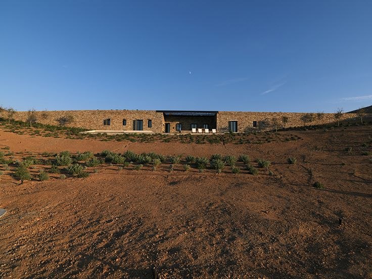 The design of the house is a dual response to the particular topography of the site and to the rural domestication techniques that in the past shaped the raw 'Cycladic island' landscape. In the past, dry-rubble stone walls domesticated the land for agricultural purposes and were the most prominent man-made interventions in the landscape. #arquitectura #architecture #piedra #stone #courtyard #patiointerior #house #home #luxury #vivienda