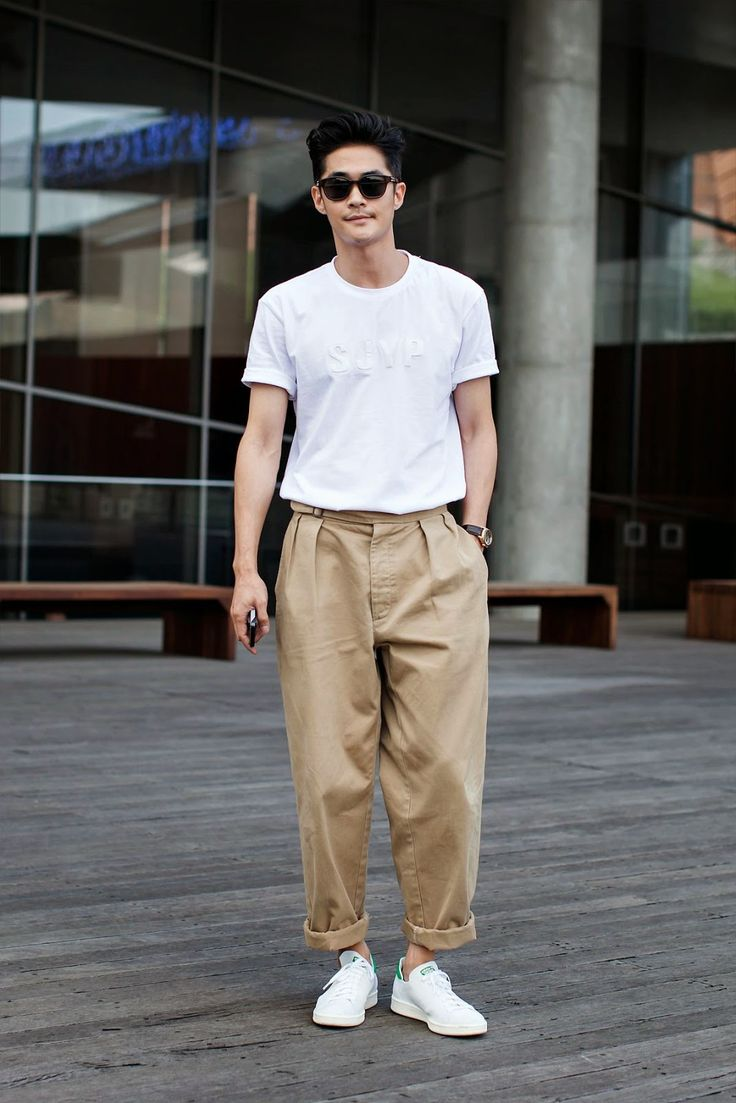 On the street... Jungnam Bae Seoul X Steve J & Yoni P echeveau. Loving wider cut trousers in neutral tones for spring/ summer.