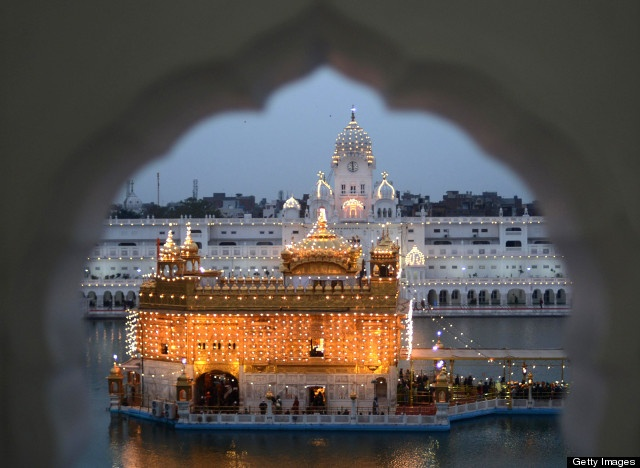 Indian Sikh devotees pay their respects at the illuminated Golden Temple in Amritsar on January 17, 2013, on the eve of the 348th Birth Anniversary of tenth Sikh Guru Gobind Singh