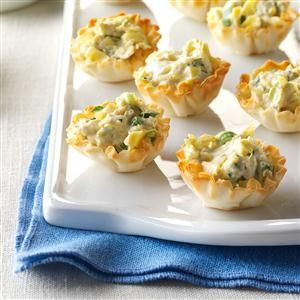 Artichoke Phyllo Cups Recipe -One of my favorite appetizers (which I find addicting!) is spinach and artichoke dip. I wanted to create a bite-size version that captures the savory richness in a baked phyllo cup. —Neel Patel, Champaign, Illinois