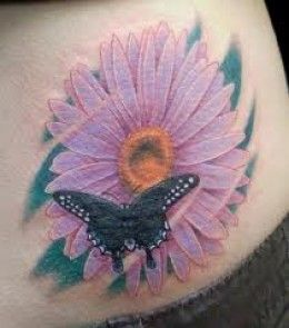 Daisy Flower Tattoos| InkDoneRight  Daisies are a simple and widely commonplace flower, but they make for a striking image in ink. Daisy tattoos can come in a huge variety of colors and...