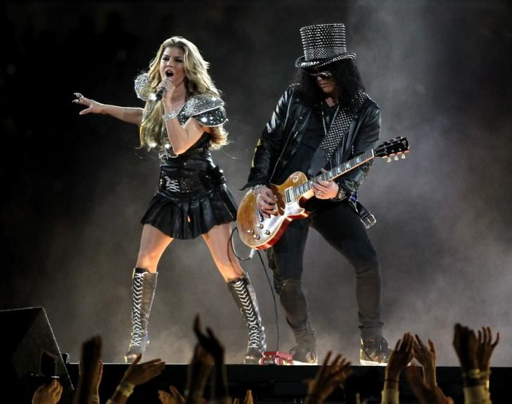 """The Peas, fronted by Fergie, performed a medley of their hit songs such as """"I Gotta Feeling,"""" """"Let's Get It Started,"""" and """"Where Is the Love?,"""" as well as Guns 'N Roses' """"Sweet Child O' Mine,"""" and Usher's """"OMG."""""""