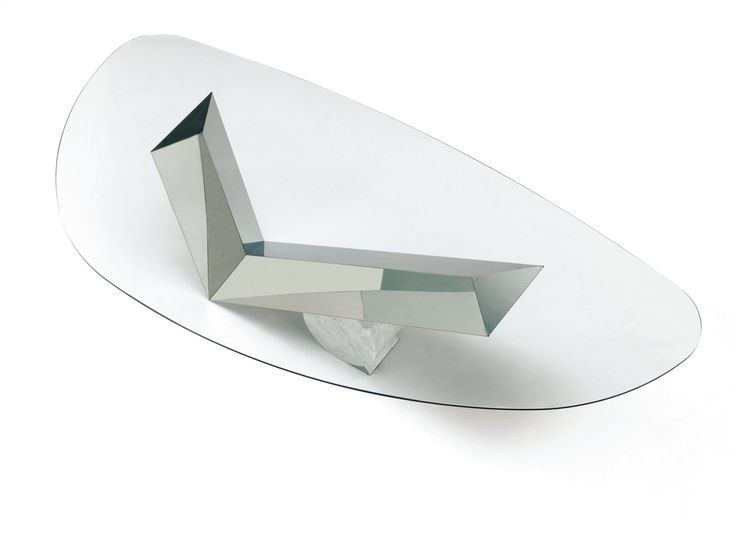 A Contemporary Dining Table Design With A Glass Table Top And A Feature  Base Of Stainless
