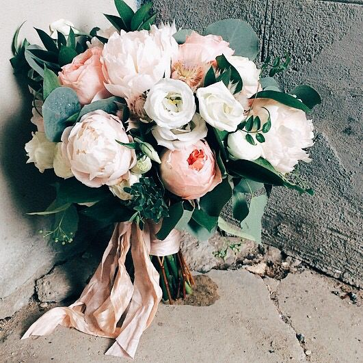 Designed by @theflowercult. Garden style bridal bouquet including Juliet garden roses, white peonies, lisianthus, blushing bride protea, jasmine and eucalyptus. For a contemporary wedding.