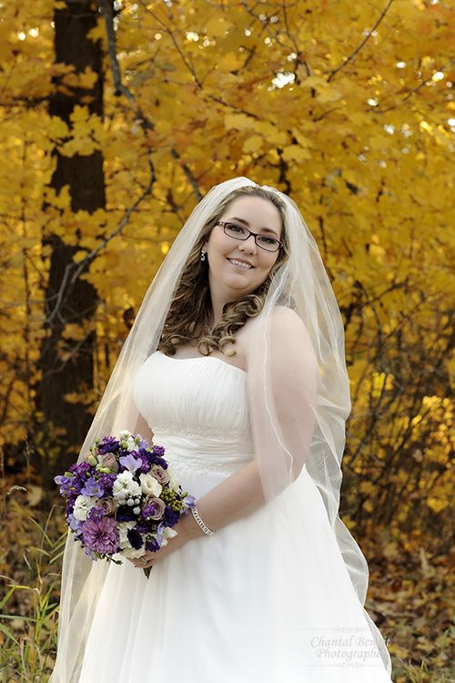 Fall Wedding photo of bride on the side of a street in Cumberland Ontario