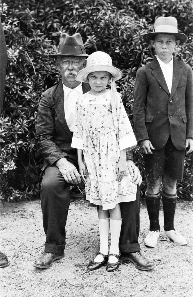 """Ca. 1925 Herbert John """"Jack"""" COLMAN with son William Henry """"Bill"""" and daughter Edith Grace, at Hope Street, Cooktown."""