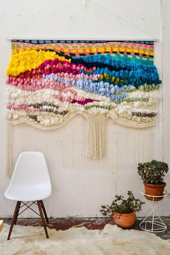 Gorgeous rainbow handwoven tufted merino roving hanging wall weaving with fringe and an assortment of rainbow bright hues.