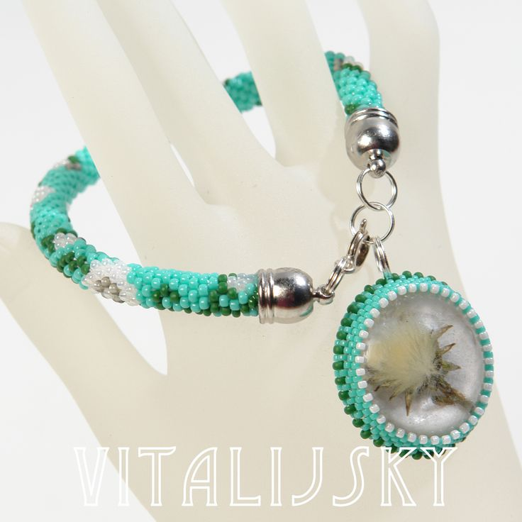 bracelet, cabochon of resin with natural dendalion, bead crochet rope